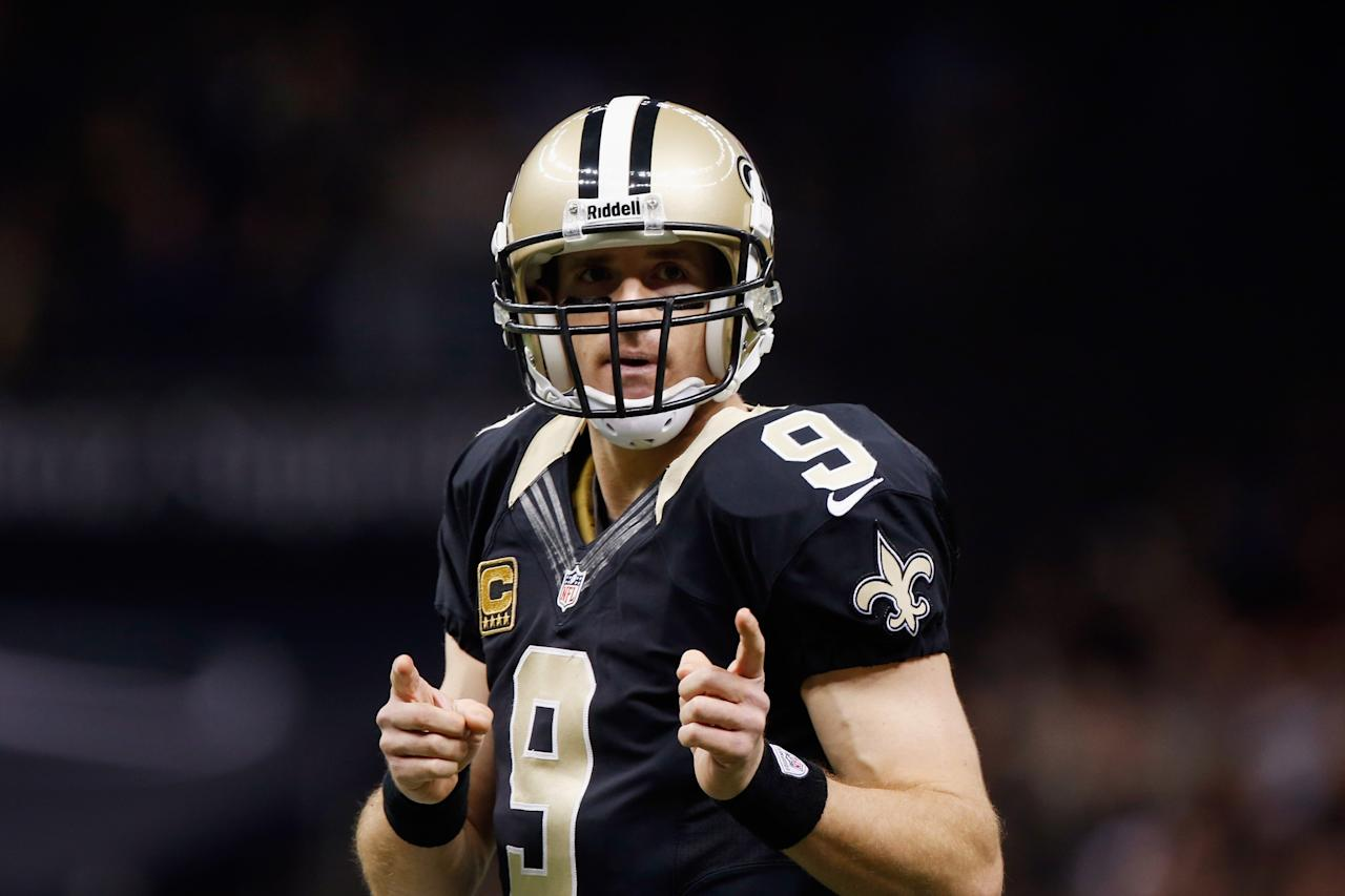 NEW ORLEANS, LA - DECEMBER 30:   Drew Brees #9 of the New Orleans Saints reacts during the game against the Carolina Panthers at the Mercedes-Benz Superdome on December 30, 2012 in New Orleans, Louisiana.  (Photo by Chris Graythen/Getty Images)