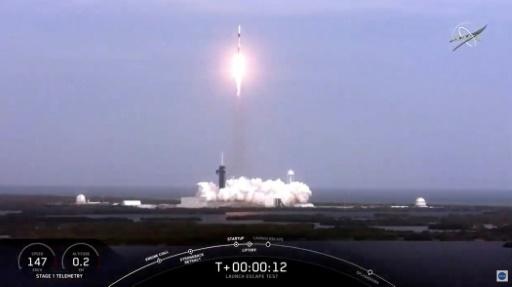 This NASA TV video frame grab shows a SpaceX rocket launching to perform an in-flight abort test of its Crew Dragon spacecraft, which was unmanned for the apparently successful test