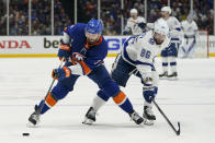 New York Islanders defenseman Adam Pelech (3) controls the puck against Tampa Bay Lightning right wing Nikita Kucherov (86) during the third period of Game 3 of the NHL hockey Stanley Cup semifinals, Thursday, June 17, 2021, in Uniondale, N.Y. (AP Photo/Frank Franklin II)