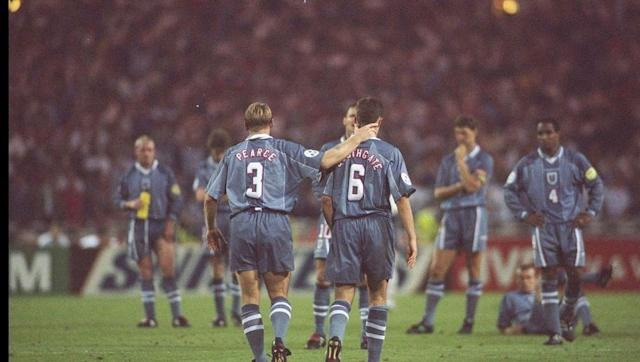 <p>Six years later brought more penalty woe for the hosts.</p> <br><p>As football came home at Euro '96, there was a genuine feeling that England could win their first trophy in 30 years. </p> <br><p>After overcoming their penalty hoodoo in the quarter-final versus Spain, the consensus was England were slight favourites.</p> <br><p>Indeed, the men in grey took the lead in the third minute through Alan Shearer's near-post header. The lead only stood until the 16th-minute however, when Stefan Kunst slid in at the far post to douse scenes of celebration in Wembley.</p> <br><p>Like Italia '90, penalties were a clinic. Then at 5-5 and sudden death, Gareth Southgate stepped up but his tame penalty was stopped by Andreas Kopke in the German goal as a nation's hearts sank, and a pizza franchise swooped in for the forlorn defender.</p> <br><p>All that was left was for Andreas Moller to smash his effort high into the net and home,</p> <p>despite David Seaman's best efforts. England were out, a nation left inconsolable.</p>