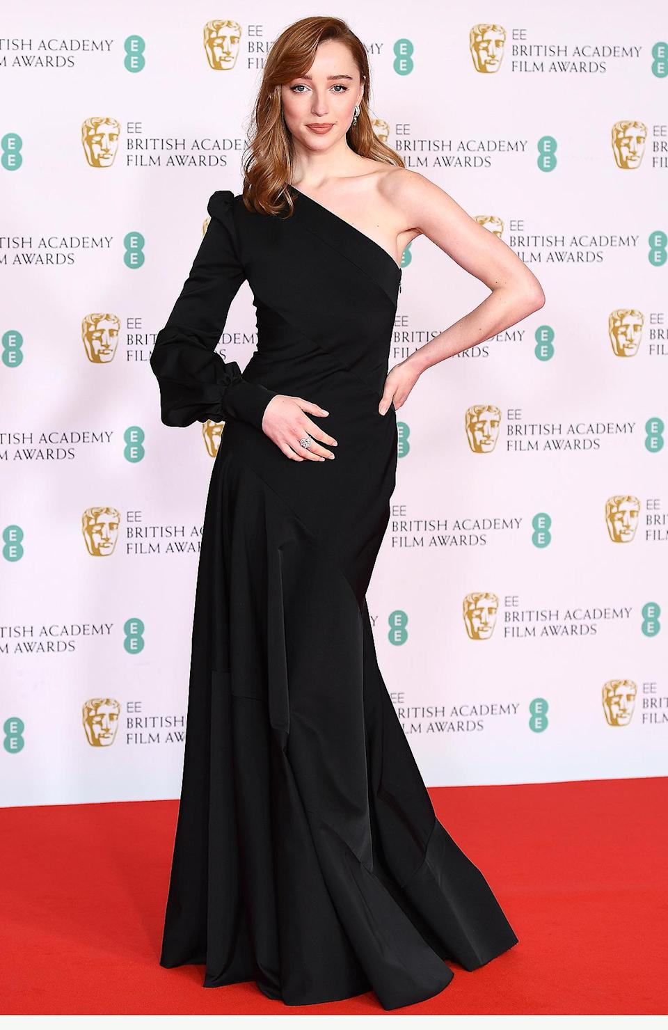 <p>makes her red carpet debut in a custom Louis Vuitton gown, with earrings and ring from the brand's High Jewelry collection. </p>