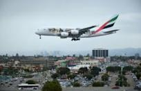 Weary flyers shrug as Middle East laptop ban takes off