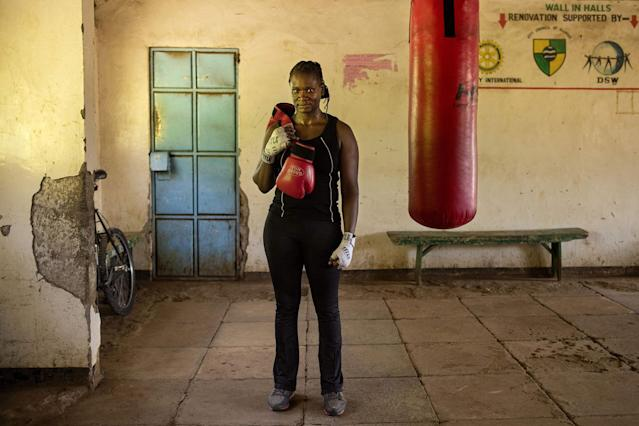 <p>Sarah Achieng a 31-year-old professional boxer and sports administrator, poses after her training session at Kariobangi social hall gym in Nairobi on February 27, 2018. (Photo: Patricia Esteve/AFP/Getty Images) </p>