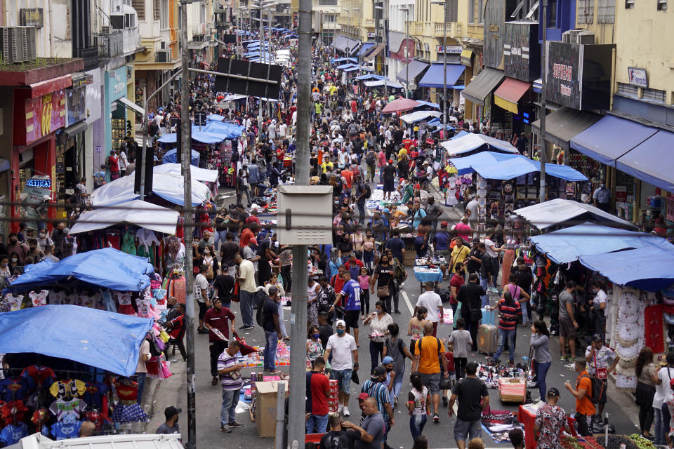 People walk in a popular street market before Christmas, amid the coronavirus disease (COVID-19) outbreak, in São Paulo, Brazil, December 24, 2020.  (Photo by Cris Faga/NurPhoto via Getty Images)