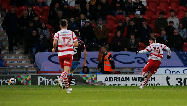 Soccer Football - FA Cup Second Round - Doncaster Rovers vs Scunthorpe United - Keepmoat Stadium, Doncaster, Britain - December 3, 2017 Doncaster Rovers' Liam Mandeville (R) scores his sides third goal Action Images/Craig Brough