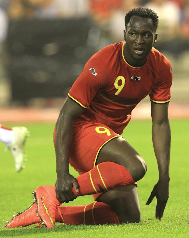 Belgium's Romelu Lukaku touches his ankle during a friendly soccer match against Tunisia, at the King Baudouin stadium in Brussels, Saturday, June 7, 2014. Belgium will play against South Korea, Russia and Algeria in Group H of the World Cup 2014 in Brazil. (AP Photo/Yves Logghe)