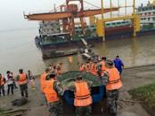 Rescue workers carry a boat to conduct a search after a ship sank at the Jianli section of Yangtze River, Hubei province, China, June 2, 2015. REUTERS/Stringer