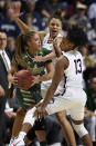 Connecticut's Olivia Nelson-Ododa, back center, and Connecticut's Christyn Williams, right, pressure South Florida's Elena Tsineke during the second half of an NCAA college basketball game in the American Athletic Conference tournament semifinals at Mohegan Sun Arena, Sunday, March 8, 2020, in Uncasville, Conn. (AP Photo/Jessica Hill)