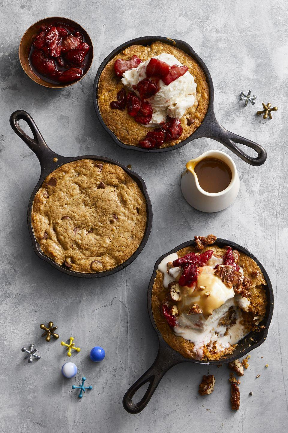 "<p>This warm and melty chocolate chip skillet cookie is customizable for the ultimate fall dessert for a crowd. We'll be topping ours with candied pecans and miso caramel, thank you.</p><p><em><a href=""https://www.goodhousekeeping.com/food-recipes/dessert/a47671/skillet-cookie-sundaes-recipe/"" rel=""nofollow noopener"" target=""_blank"" data-ylk=""slk:Get the recipe for Skillet Cookie Sundaes »"" class=""link rapid-noclick-resp"">Get the recipe for Skillet Cookie Sundaes »</a></em> </p>"