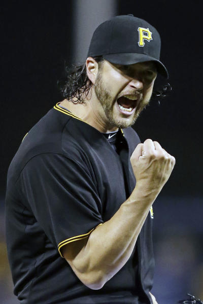 Pittsburgh Pirates relief pitcher Jason Grilli (39) celebrates after getting the final out of the ninth inning during a baseball game against the Cincinnati Reds in Pittsburgh Saturday, Sept. 21, 2013. Grilli got his 31st save of the season in the 4-2 Pirates win. (AP Photo/Gene J. Puskar)