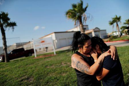 Isabela, an asylum seeker from El Salvador, hugs her 17-year-old daughter Dayana outside of Casa Esperanza, a federal contracted shelter in Brownsville, Texas, U.S., shortly after being reunited with her following their separation at the U.S.-Mexico border. REUTERS/Carlos Barria
