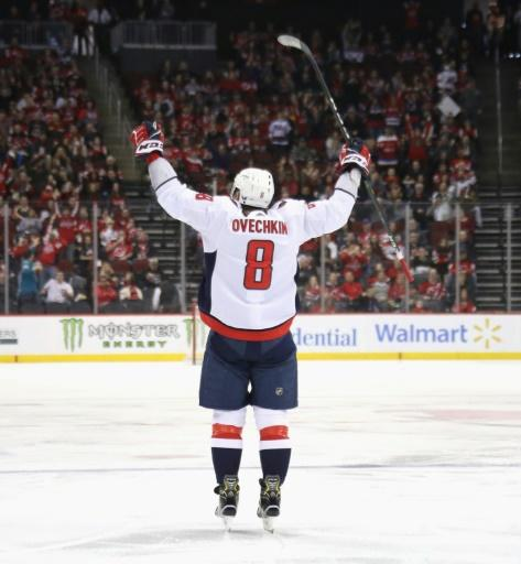 Washington's Alex Ovechkin celebrates his 700th career NHL goal on Saturday, becoming only the eighth player in league history to reach the miletone