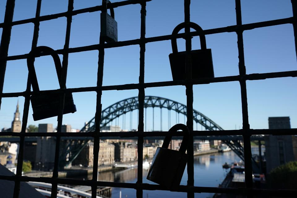 Padlocks on a bridge over the River Tyne in Newcastle. Ministers are considering imposing fresh regional restrictions amid a spike in coronavirus cases in northern England.