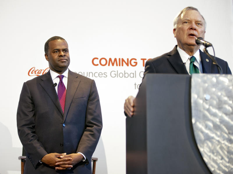 In this May 8, 2013 photo, Georgia Gov. Nathan Deal, right, and Atlanta Mayor Kasim Reed, attend an event where the the Coca-Cola Foundation pledged $3.8 million to support statewide initiatives aimed at boosting fitness and health in Atlanta. In this era of hyper-partisan rhetoric, the unique friendship that has developed between Deal and Reed has its roots in a shared interest in economic development and has blossomed into a powerful political alliance that is paying dividends. (AP Photo/David Goldman)
