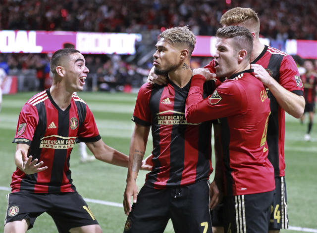 "Miguel Almiron (from left), <a class=""link rapid-noclick-resp"" href=""/soccer/players/383782/"" data-ylk=""slk:Josef Martinez"">Josef Martinez</a>, <a class=""link rapid-noclick-resp"" href=""/soccer/players/460384/"" data-ylk=""slk:Greg Garza"">Greg Garza</a> and Atlanta United are all but in MLS Cup after beating the <a class=""link rapid-noclick-resp"" href=""/soccer/teams/new-york-red-bulls/"" data-ylk=""slk:New York Red Bulls"">New York Red Bulls</a> 3-0 on Sunday. (Curtis Compton/AP) <span> <br></span>"