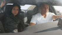 """Cinema's most dysfunctional """"family"""" is back with another blockbuster spectacle of cars smashing into various structures. <a href=""""https://uk.movies.yahoo.com/john-cena-promises-that-fast-furious-9-will-answer-franchise-questions-235740881.html"""" data-ylk=""""slk:John Cena is new to the cast;outcm:mb_qualified_link;_E:mb_qualified_link;ct:story;"""" class=""""link rapid-noclick-resp yahoo-link"""">John Cena is new to the cast</a> as the secret assassin brother of Vin Diesel's vehicular vigilante Dom Toretto. There's also the enigma of <a href=""""https://uk.movies.yahoo.com/sung-kang-on-hans-shocking-return-in-fast-furious-9-230306188.html"""" data-ylk=""""slk:Sung Kang's return;outcm:mb_qualified_link;_E:mb_qualified_link;ct:story;"""" class=""""link rapid-noclick-resp yahoo-link"""">Sung Kang's return</a> as beloved character Han, who was killed in 2006 movie <em>The Fast and the Furious: Tokyo Drift</em>. How is he back and how will this affect the fact that his killer, Jason Statham, is now a member of the crew — albeit one who will not be appearing in this movie? And that's not to mention the <a href=""""https://uk.movies.yahoo.com/michelle-rodriguez-fast-and-furious-9-space-084722887.html"""" data-ylk=""""slk:possibility of space;outcm:mb_qualified_link;_E:mb_qualified_link;ct:story;"""" class=""""link rapid-noclick-resp yahoo-link"""">possibility of space</a>. (Credit: Universal)"""