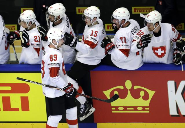 Ice Hockey - 2018 IIHF World Championships - Quarterfinals - Finland v Switzerland - Jyske Bank Boxen - Herning, Denmark - May 17, 2018 - Joel Vermin of Switzerland celebrates with teammates after scoring. REUTERS/David W Cerny