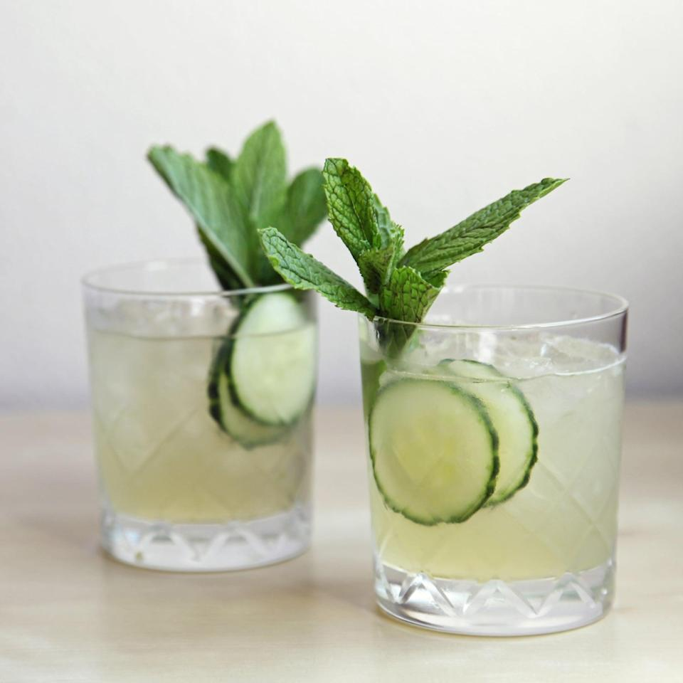 """<p>Shake up the traditional mojito by giving it a drool-worthy gin spin. Since gin only has 73 calories in an ounce, this <a href=""""https://www.popsugar.com/food/Cucumber-Mint-Gin-Cocktail-34793556"""" class=""""link rapid-noclick-resp"""" rel=""""nofollow noopener"""" target=""""_blank"""" data-ylk=""""slk:cucumber-mint gin cocktail"""">cucumber-mint gin cocktail</a> recipe is super light and super refreshing. </p> <p><strong>Ingredients: </strong></p> <ul> <li>5 cucumber slices, divided</li> <li>2 sprigs of mint</li> <li>3/4 ounce simple syrup</li> <li>3/4 ounce freshly squeezed lime juice</li> <li>1 1/2 ounces gin, such as Beefeater 24</li> </ul> <p><strong>Directions</strong>: Add three slices of cucumber, the leaves from a sprig of mint, and the simple syrup to a cocktail shaker. Muddle. Add the lime juice, gin, and ice, and shake until chilled. Strain into an ice-filled old-fashioned glass. Spank the remaining sprig of mint before garnishing the cocktail with it and the remaining two slices of cucumber.</p>"""
