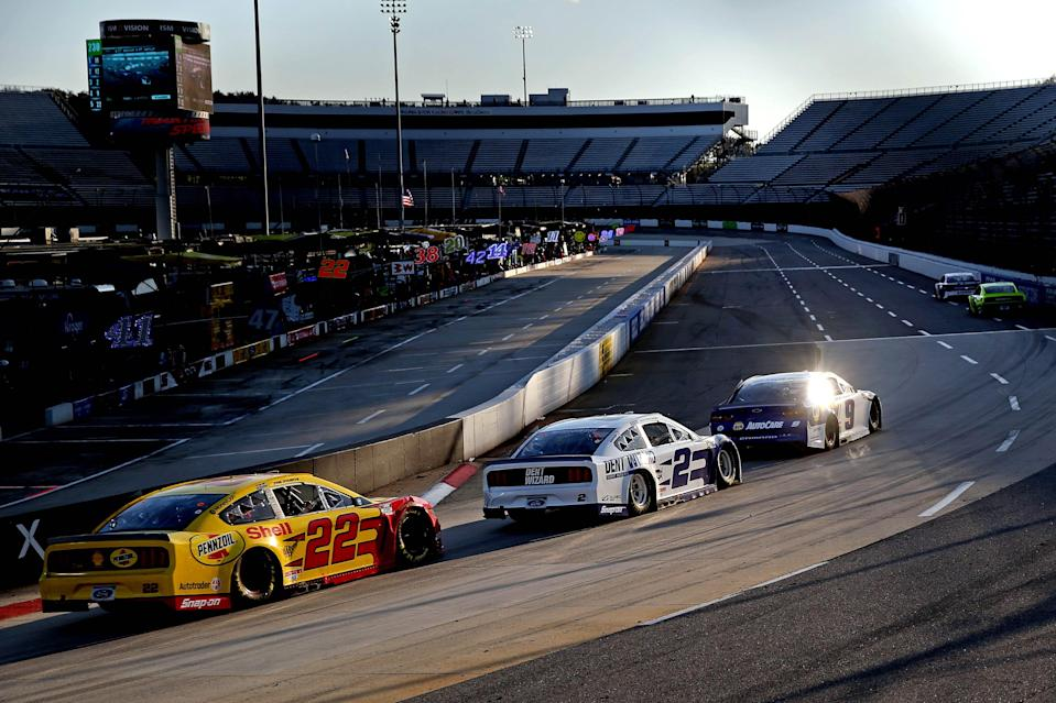 Chase Elliott (9) leads  Joey Logano (22) and Brad Keselowski (2) during the 2020 playoff race at Martinsville Speedway.