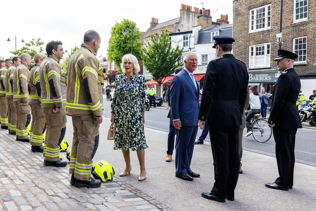 Britain's Prince Charles, Prince of Wales and Britain's Camilla, Duchess of Cornwall meet firefighters outside Clapham Fire Station during their visit to Clapham Old Town, south London on May 27, 2021. (Photo by Heathcliff O'Malley / POOL / AFP) (Photo by HEATHCLIFF O'MALLEY/POOL/AFP via Getty Images)