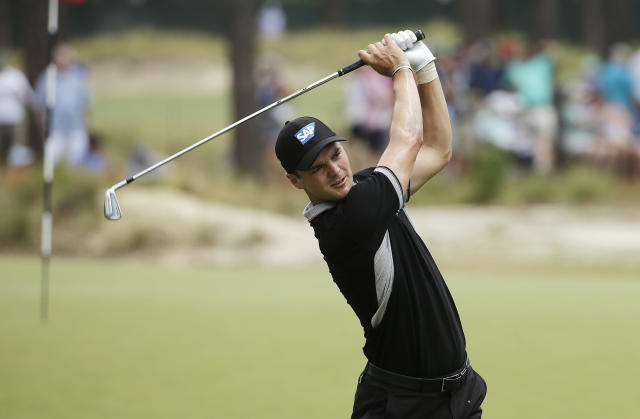 Martin Kaymer, of Germany, watches his tee shot on the seventh hole during the second round of the U.S. Open golf tournament in Pinehurst, N.C., Friday, June 13, 2014. (AP Photo/Chuck Burton)
