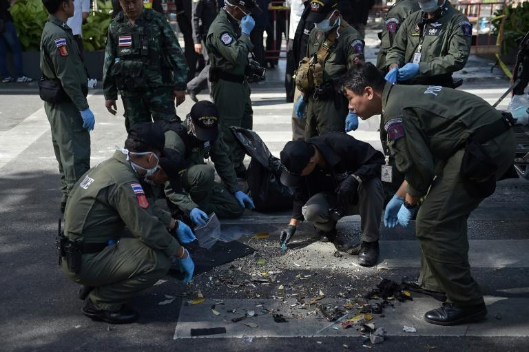 Police inspect the cordoned-off site of a bomb blast at the popular Erawan shrine in the heart of Bangkok's tourist and commercial centre, on August 18, 2015