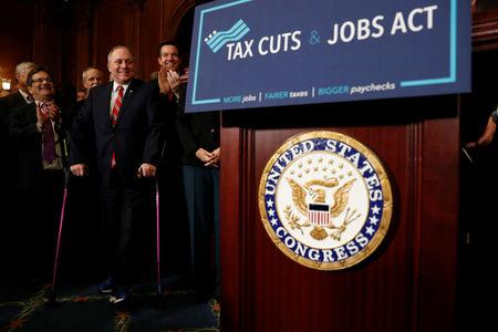 "House Majority Whip Rep. Steve Scalise (R-LA) looks on during a news conference announcing the passage of the ""Tax Cuts and Jobs Act"" at the U.S. Capitol in Washington"