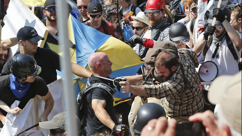White nationalist demonstrators clash with counter protesters at a Virginia rally in the US