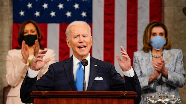 President Joe Biden addresses a joint session of Congress, with Vice President Kamala Harris and House Speaker Nancy Pelosi (D-CA) on the dais behind him on April 28, 2021 in Washington, DC.(Photo by Melina Mara-Pool/Getty Images)