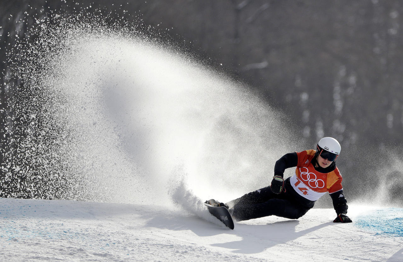 <p>Lee Sangho, of South Korea, runs the course during the men's parallel giant slalom quarterfinals at Phoenix Snow Park at the 2018 Winter Olympics in Pyeongchang, South Korea, Saturday, Feb. 24, 2018. (AP Photo/Gregory Bull) </p>