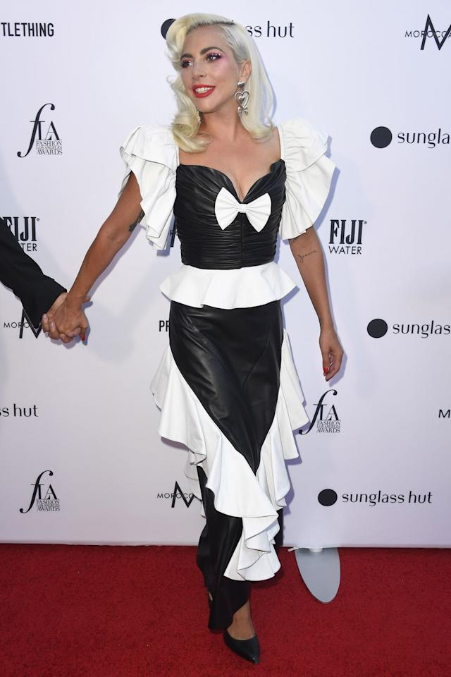 <p><strong>17 March </strong>Lady Gaga wore a monochrome Rodarte leather dress with a feminine bow and frills. <strong></strong></p>