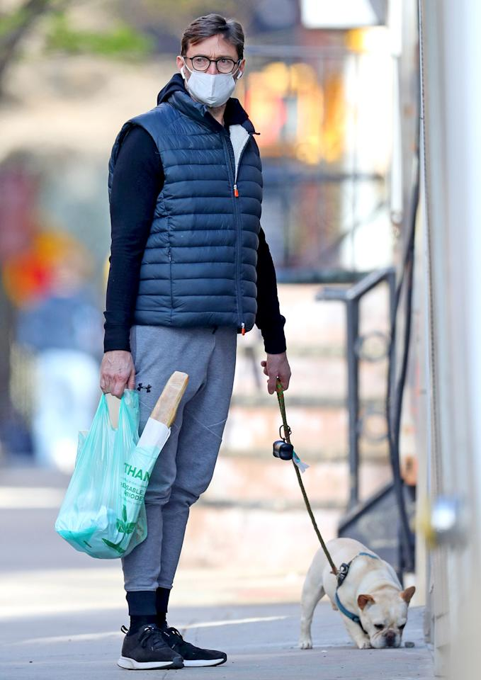 <p>Hugh Jackman and his French bulldog go for a stroll in New York City on Wednesday.</p>