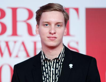 FILE PHOTO - George Ezra arrives at the Brit Awards at the O2 Arena in London, Britain, February 21, 2018. REUTERS/Eddie Keogh