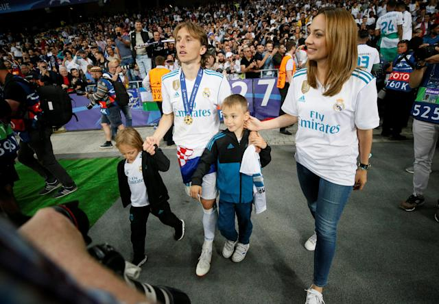 Soccer Football - Champions League Final - Real Madrid v Liverpool - NSC Olympic Stadium, Kiev, Ukraine - May 26, 2018 Real Madrid's Luka Modric celebrates with his family after winning the Champions League REUTERS/Gleb Garanich