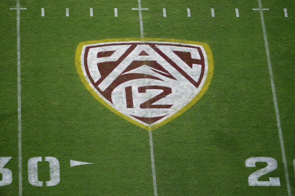 FILE - This Aug. 29, 2019, file photo shows the PAC-12 logo at Sun Devil Stadium during second half of an NCAA college football game between Arizona State and Kent State in Tempe, Ariz. There are 130 major college football teams, spread across 41 states and competing in 10 conferences, save for a handful of independents. The goal is to have all those teams start the upcoming season at the same time — whether that's around Labor Day as scheduled or later — and play the same number of games.(AP Photo/Ralph Freso, File)