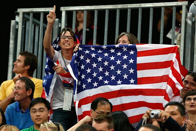 LONDON, ENGLAND - JULY 29: Fans of the United States cheer during their Men's Basketball Game against France on Day 2 of the London 2012 Olympic Games at the Basketball Arena on July 29, 2012 in London, England.. (Photo by Jamie Squire/Getty Images)