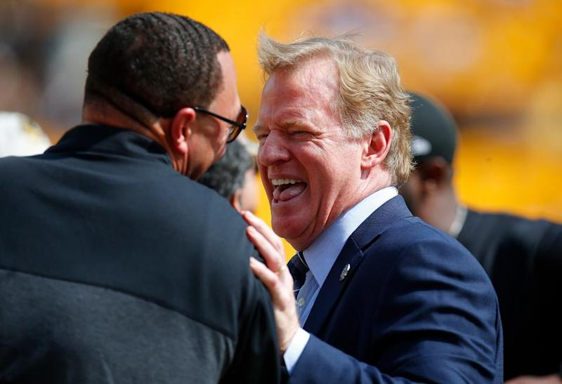 NFL Commissioner Roger Goodell shares a laugh with former Pittsburgh Steelers quarterback Charlie Batch at Heinz Field, Pittsburgh, September 17.