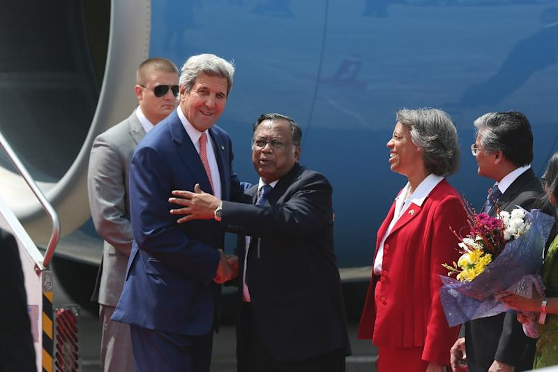 US Secretary of State John Kerry is welcomed by Bangladesh counterpart Mahmood Ali as US ambassador to the country Marcia Bernicat looks on following Kerry's arrival at Dhaka airport