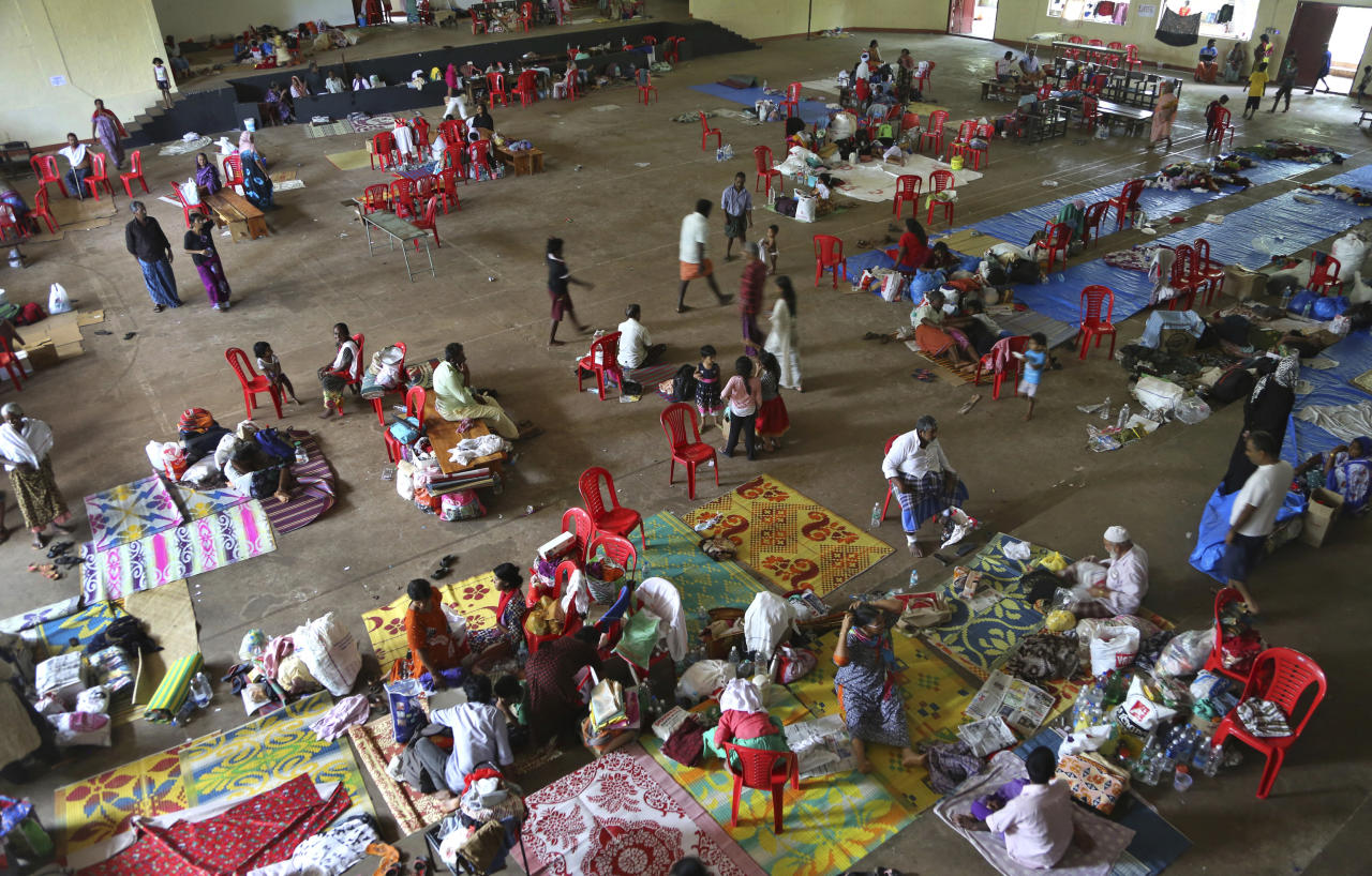 <p>People who have left their flood effected homes take refuge in a relief camp set up at a college on the outskirts of Kochin in the southern state of Kerala, India, Tuesday, Aug. 21, 2018. The Indian military is scaling down rescue operations in the southern state of Kerala, where intense floods killed more than 200 people and drove hundreds of thousands from their homes (AP Photo/Aijaz Rahi) </p>