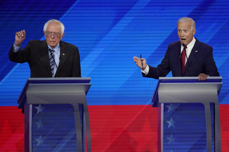Sen. Bernie Sanders, I-Vt., left, and former Vice President Joe Biden, right, speak Thursday, Sept. 12, 2019, during a Democratic presidential primary debate hosted by ABC at Texas Southern University in Houston. (AP Photo/David J. Phillip)