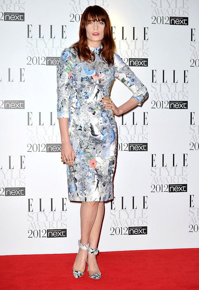 Florence and the Machine's Florence Welch, who won Best Music Act, stepped out in a floral frock from Erdem, complete with matching ankle strap shoes by Nicholas Kirkwood. We're sure she's way too cool to care what anyone thinks of the look, but we'd like to suggest she try pulling her hair back in an updo the next time she attends such a swanky soiree. (2/13/2012)