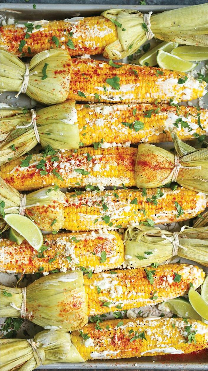 """<strong>Get the <a href=""""http://damndelicious.net/2017/06/09/roasted-mexican-street-corn/"""" rel=""""nofollow noopener"""" target=""""_blank"""" data-ylk=""""slk:Roasted Mexican Street Corn recipe"""" class=""""link rapid-noclick-resp"""">Roasted Mexican Street Corn recipe</a>&nbsp;from Damn Delicious</strong>"""