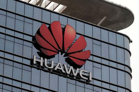 FILE PHOTO: The Huawei logo is pictured outside its Huawei's factory campus in Dongguan, Guangdong province, China March 25, 2019. REUTERS/Tyrone Siu/File Photo
