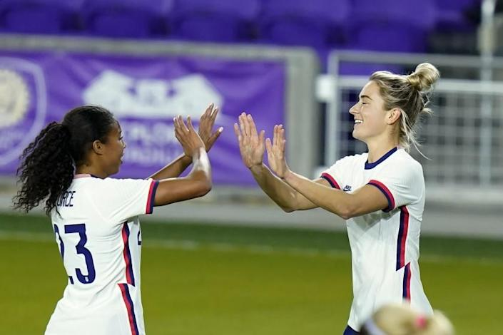 United States midfielder Kristie Mewis, right, celebrates her goal against Colombia with defender Margaret Purce.