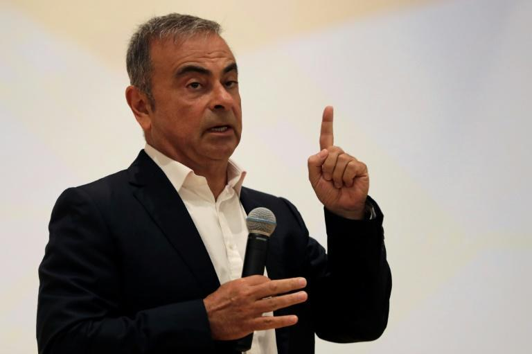 Fugitive auto tycoon Carlos Ghosn refused to answer any questions about the charges against him in Japan as he launched a business programme at a Lebanese university in his first public appearance in months