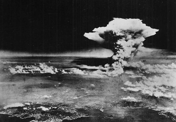 This handout picture released by the U.S. Army shows the plume of smoke from a mushroom cloud billow about one hour after the nuclear bomb was detonated above Hiroshima, Japan, on Aug. 6, 1945. Two planes participated in this mission; the Enola Gay carried and dropped the weapon, and another was an escort.
