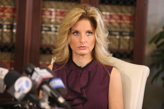 """Summer Zervos, a former candidate on """"The Apprentice"""" season five, who is accusing Donald Trump of inappropriate sexual conduct, speaks to the press on October 14, 2016 in Los Angeles, California (AFP Photo/Frederick M. Brown)"""