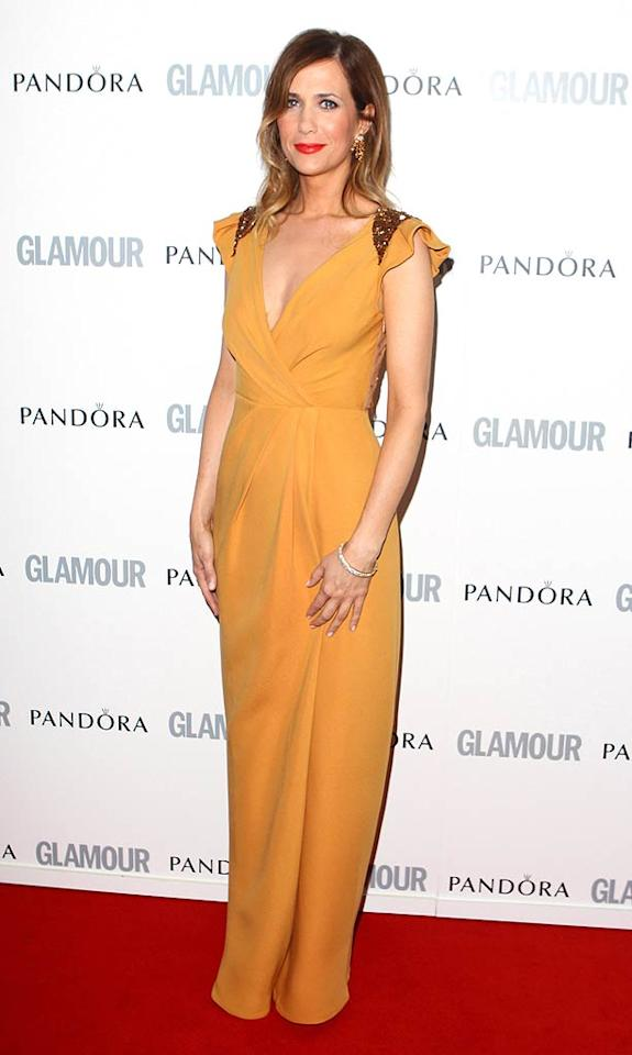 """Funny lady Kristen Wiig arrived in a much nicer frock than her """"Bridesmaids"""" dress! The actress and screenwriter was there to accept the """"Best International Newcomer Award."""" Mike Marsland/<a href=""""http://www.wireimage.com"""" target=""""new"""">WireImage.com</a> - June 7, 2011"""