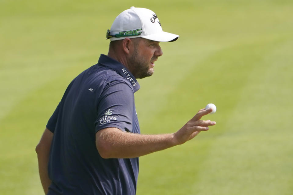 Marc Leishman, of Australia, tips his ball after a par putt on the 18th hole during the final round of the Travelers Championship golf tournament at TPC River Highlands, Sunday, June 27, 2021, in Cromwell, Conn. (AP Photo/John Minchillo)