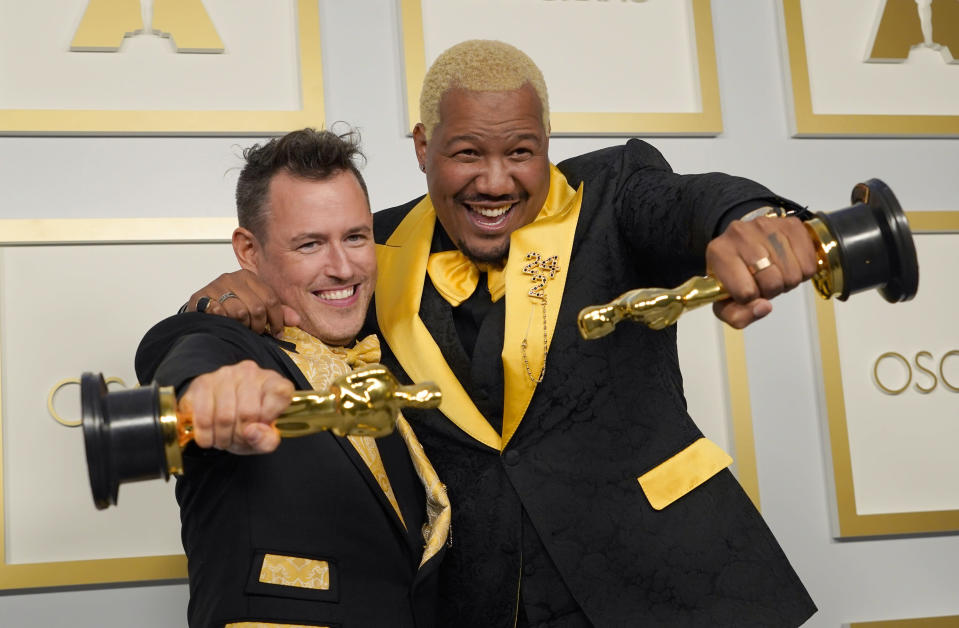 "Martin Desmond Roe, left, and Travon Free pose with award for best live action short film for ""Two Distant Strangers"" in the press room at the Oscars on Sunday, April 25, 2021, at Union Station in Los Angeles. (AP Photo/Chris Pizzello, Pool)"